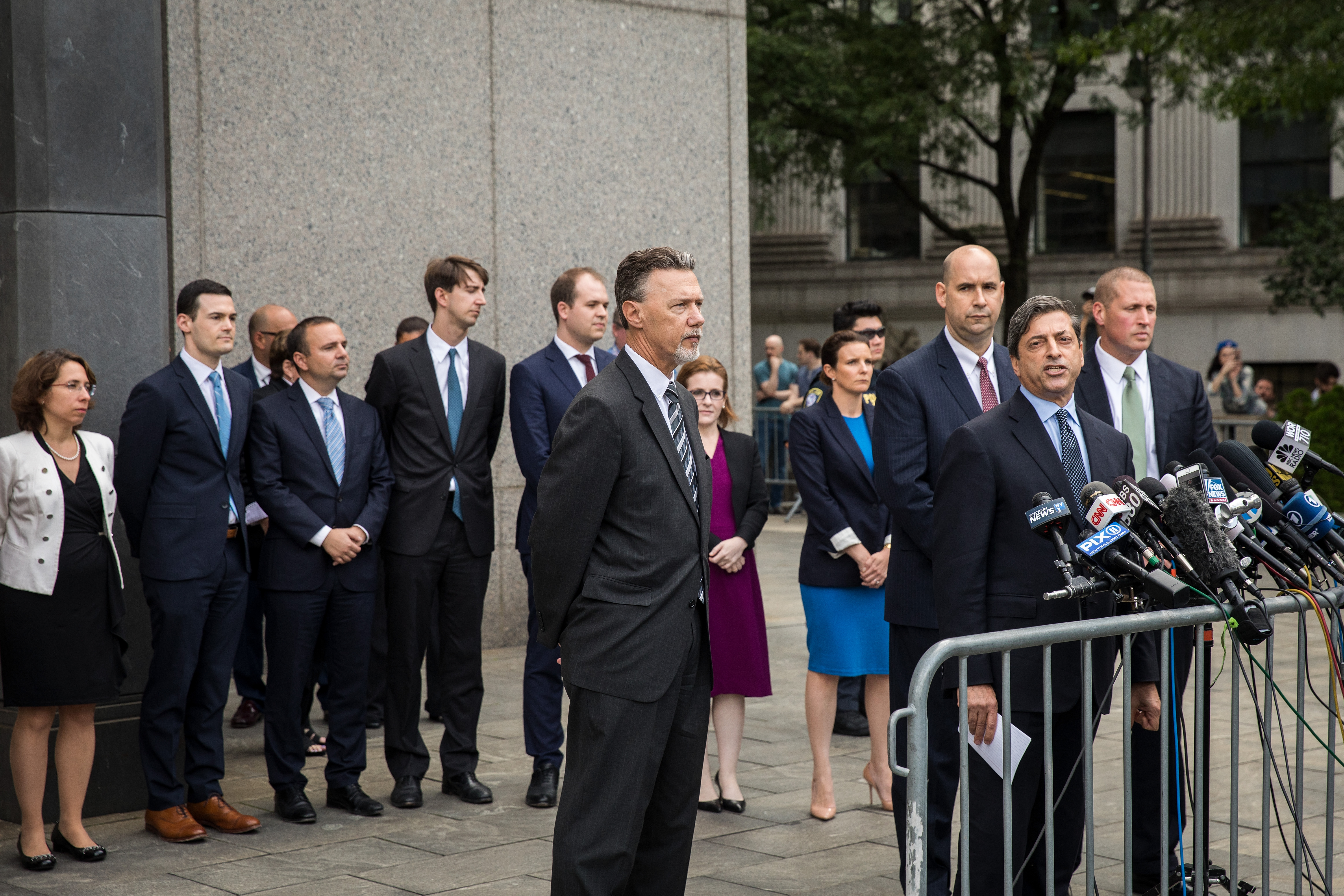 NEW YORK, NY - AUGUST 21: Surrounded by his team of lawyers, Deputy U.S. Attorney for the Southern District of New York Robert Khuzami speaks to the media about the Michael Cohen case outside of federal court, August 21, 2018 in New York City. Cohen reached a plea agreement with prosecutors involving charges of bank fraud, tax fraud and campaign finance violations. (Photo by Drew Angerer/Getty Images)