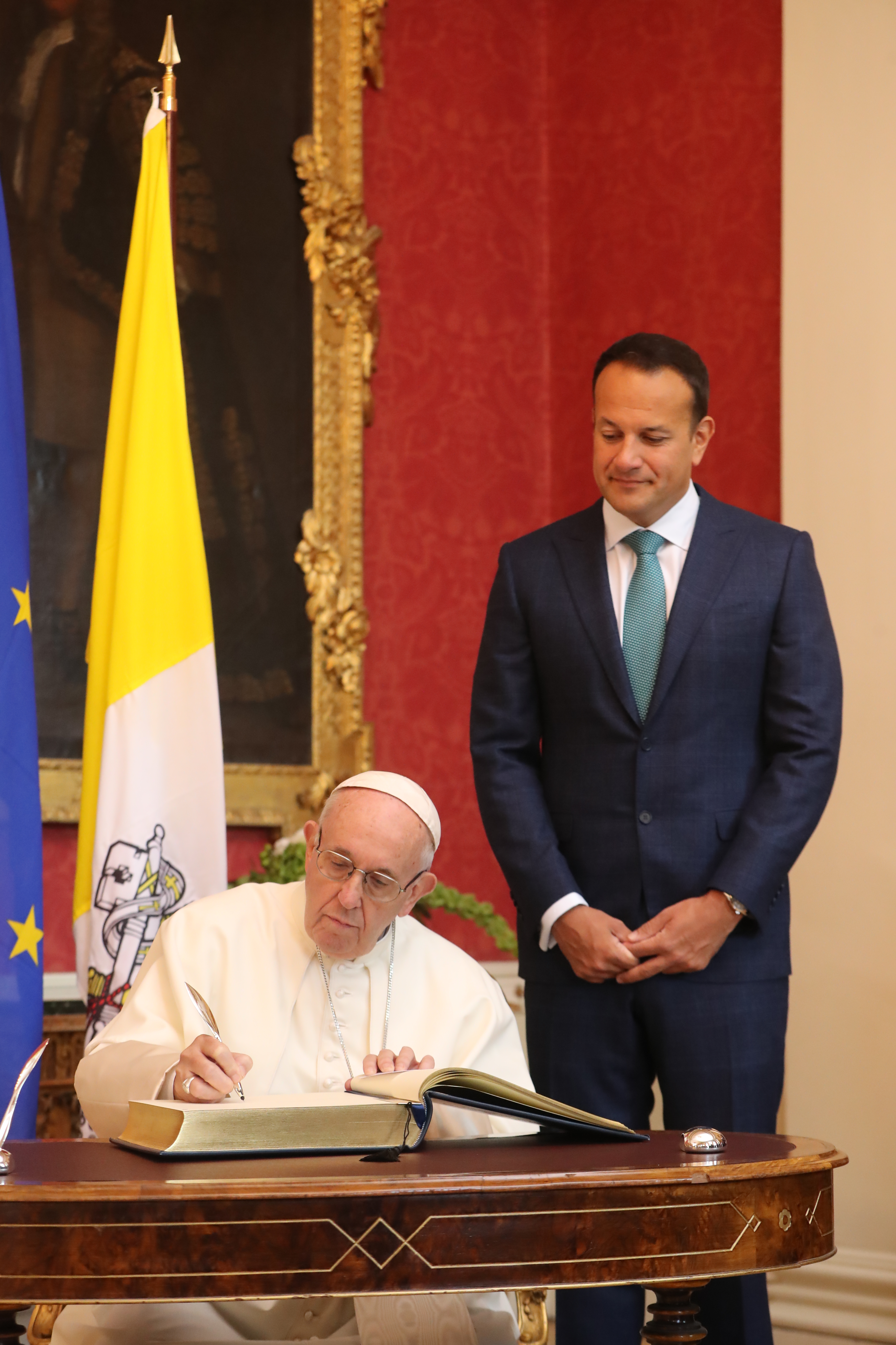DUBLIN, IRELAND - AUGUST 25: Pope Francis signs the arrivals book as he meets with Taoiseach Leo Varadkar at Dublin Castle as part of his visit to Ireland on August 25, 2018 in Dublin, Ireland. Pope Francis is the 266th Catholic Pope and current sovereign of the Vatican. His visit, the first by a Pope since John Paul II's in 1979, is expected to attract hundreds of thousands of Catholics to a series of events in Dublin and Knock. During his visit he will have private meetings with victims of sexual abuse by Catholic clergy. (Photo by NIall Carson - Pool/Getty Images)