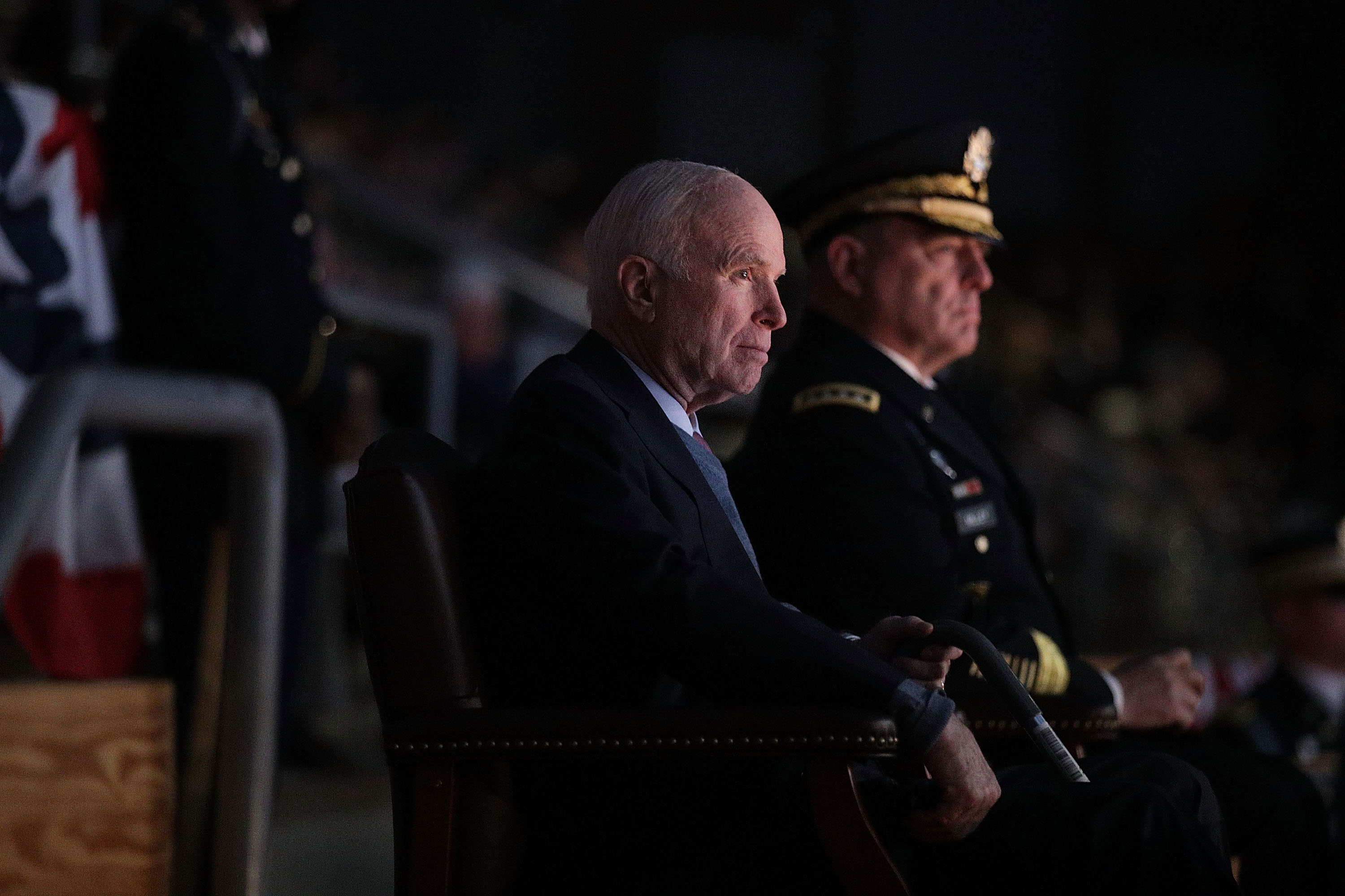 ARLINGTON, VA - NOVEMBER 14: U.S. Army Chief of Staff Gen. Mark A. Milley (R) and Sen. John McCain (R-AZ) (L) watch a special Twilight Tattoo performance November 14, 2017 at Fort Myer in Arlington, Virginia. Sen. McCain was honored with the Outstanding Civilian Service Medal for over 63 years of dedicated service to the nation and the U.S. Navy. (Photo by Alex Wong/Getty Images)