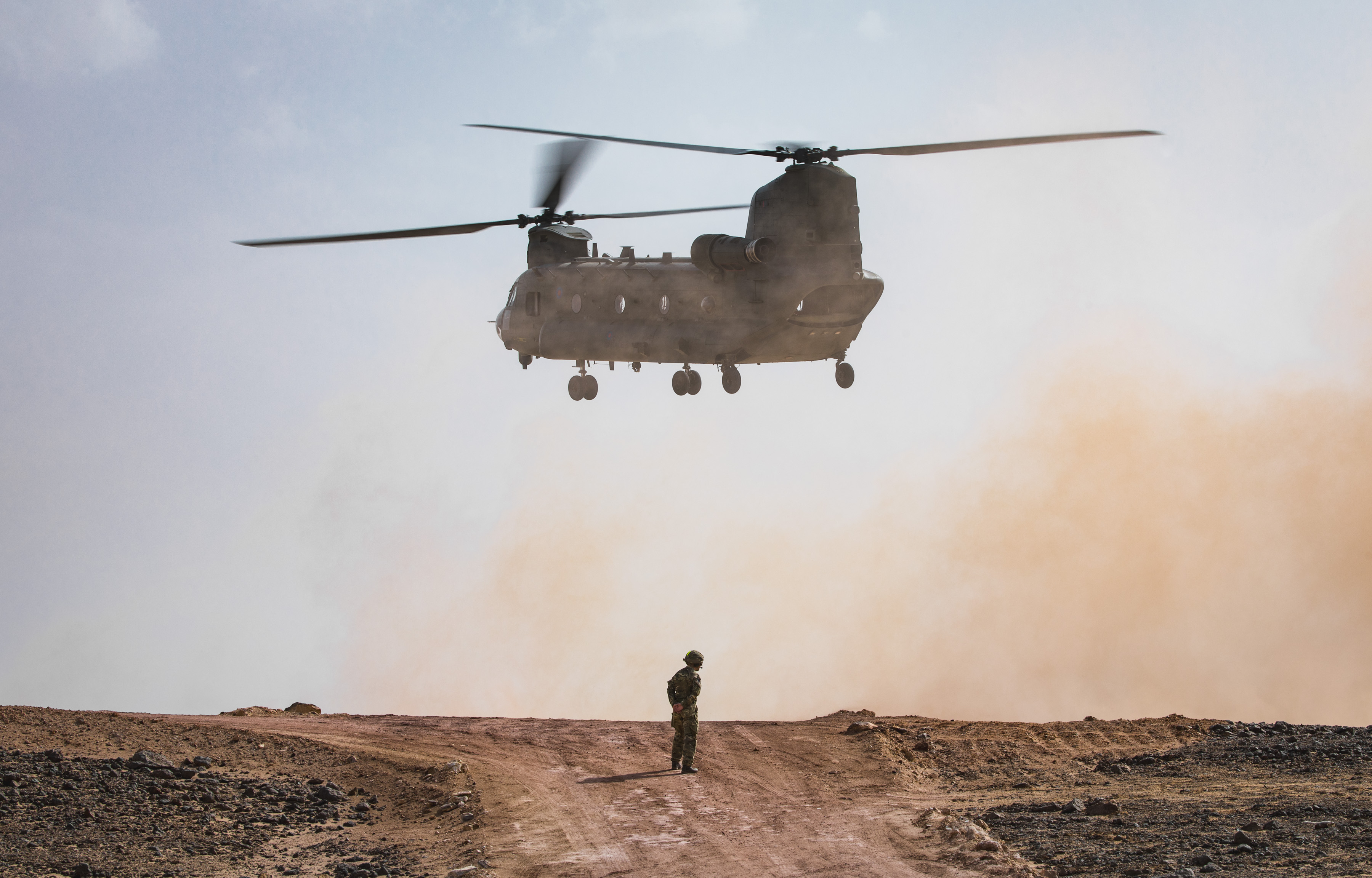 Pictured: A No. 27 Squadron RAF Chinook helicopter lands at the Fire Power Demonstration Area in order to collect the VVIPs and VIPs. British and Omani Militaries combined forces over the last few weeks on Exercise Saif Sareea 3, culminating in an awesome fire power demonstration lasting more than 30 minutes at two separate locations in Oman. On 3 Nov 18 a Fire Power Demonstration brought weeks of hard work together in a series of simulated attacks on targets. Streamed live to a VIP area in an inland location, an amphibious assault by Royal Marines and Omani troops onto a beach location in Eastern Oman with fast-roping from RAF Chinook helicopters of 27 Squadron, combined with Naval gunfire support formed the first element of the demonstration. The second phase, viewed by Omani Officers and Officials, Gavin Williamson the UK Secretary of State for Defence, and the Chiefs of UK Defence Forces, started after Omani Air Defences shot down a 'rogue' drone aircraft. This was followed closely by various attacks from the air and ground. This included airstrikes by RAF Typhoons, Omani F-16s, Omani Super Lynx and Army Air Corps Apache helicopters before Javelin anti-tank weapon firing destroyed more targets.