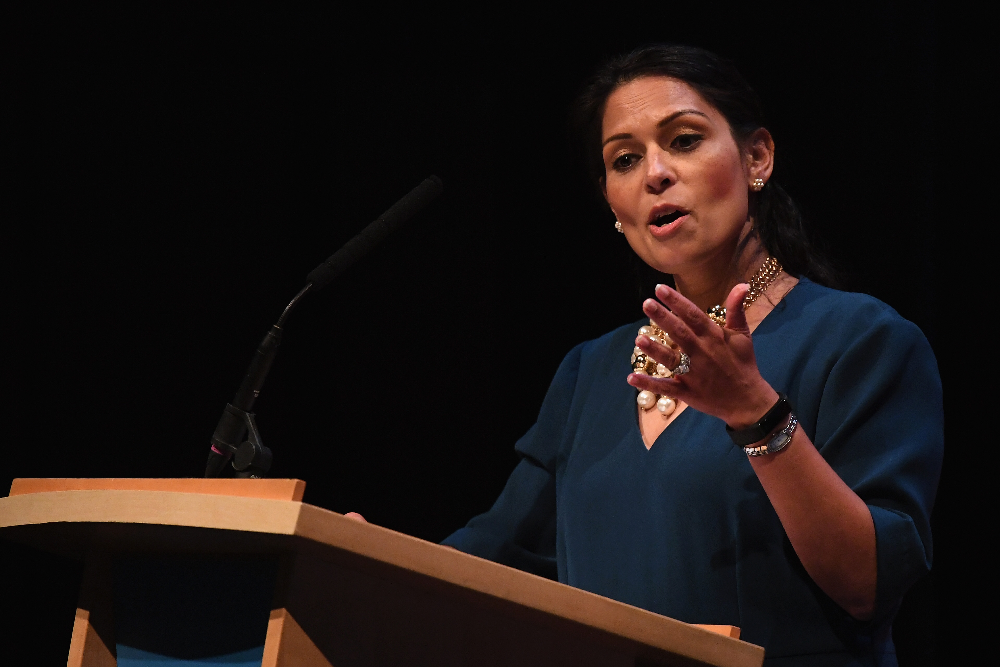 BIRMINGHAM, ENGLAND - SEPTEMBER 30: Secretary of State for International Development Priti Patel speaks during the annual Conservative Party Conference on September 30, 2018 in Birmingham, England. The Conservative Party Conference 2018 is taking place at Birmingham's International Convention Centre (ICC) from September 30 to October 3. (Photo by Jeff J Mitchell/Getty Images)