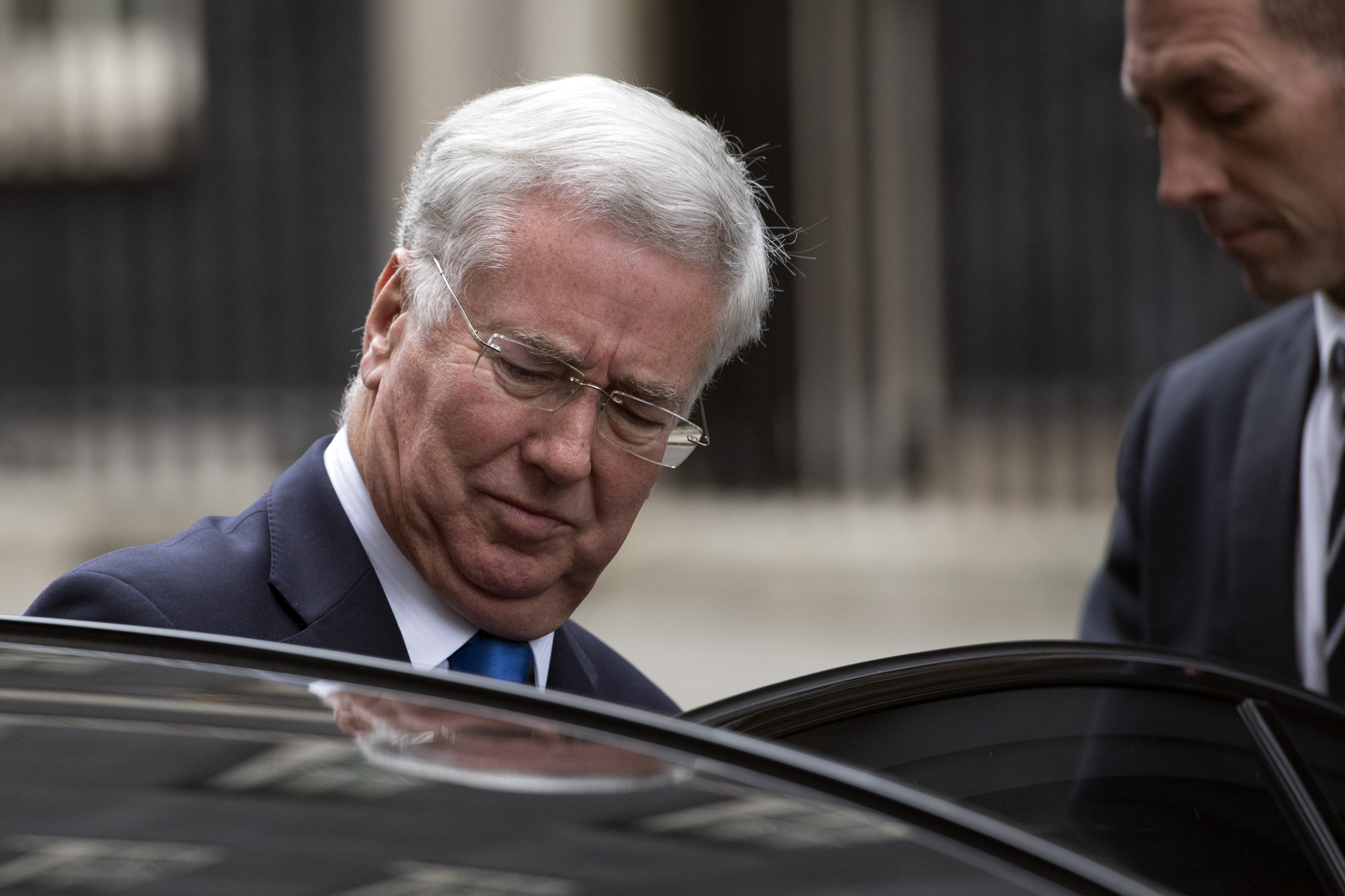 LONDON, ENGLAND - OCTOBER 31: Defence secretary Michael Fallon leaves after attending a cabinet meeting in Downing Street on October 31, 2017 in London, England. The Prime Minister is expected to discuss claims of sexual misconduct amongst members of parliament and Commons staff. (Photo by Carl Court/Getty Images)