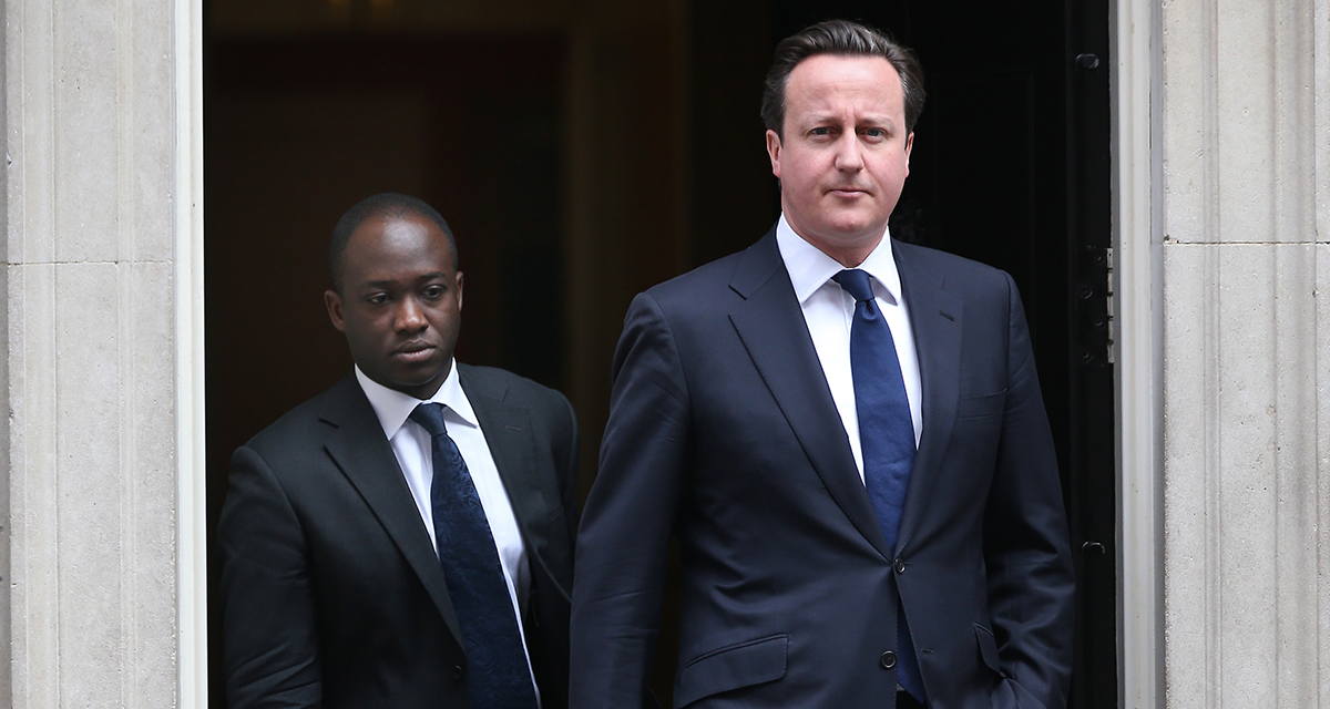 LONDON, UNITED KINGDOM - APRIL 10: Prime Minister David Cameron (R) leaves Downing Street with his Parliamentary Private Secretary Sam Gyimah on April 10, 2013 in London, England. Parliament has been recalled today to allow MPs and Peers to pay their respects to former Prime Minister Lady Thatcher who died on April 8, 2013. (Photo by Peter Macdiarmid/Getty Images)