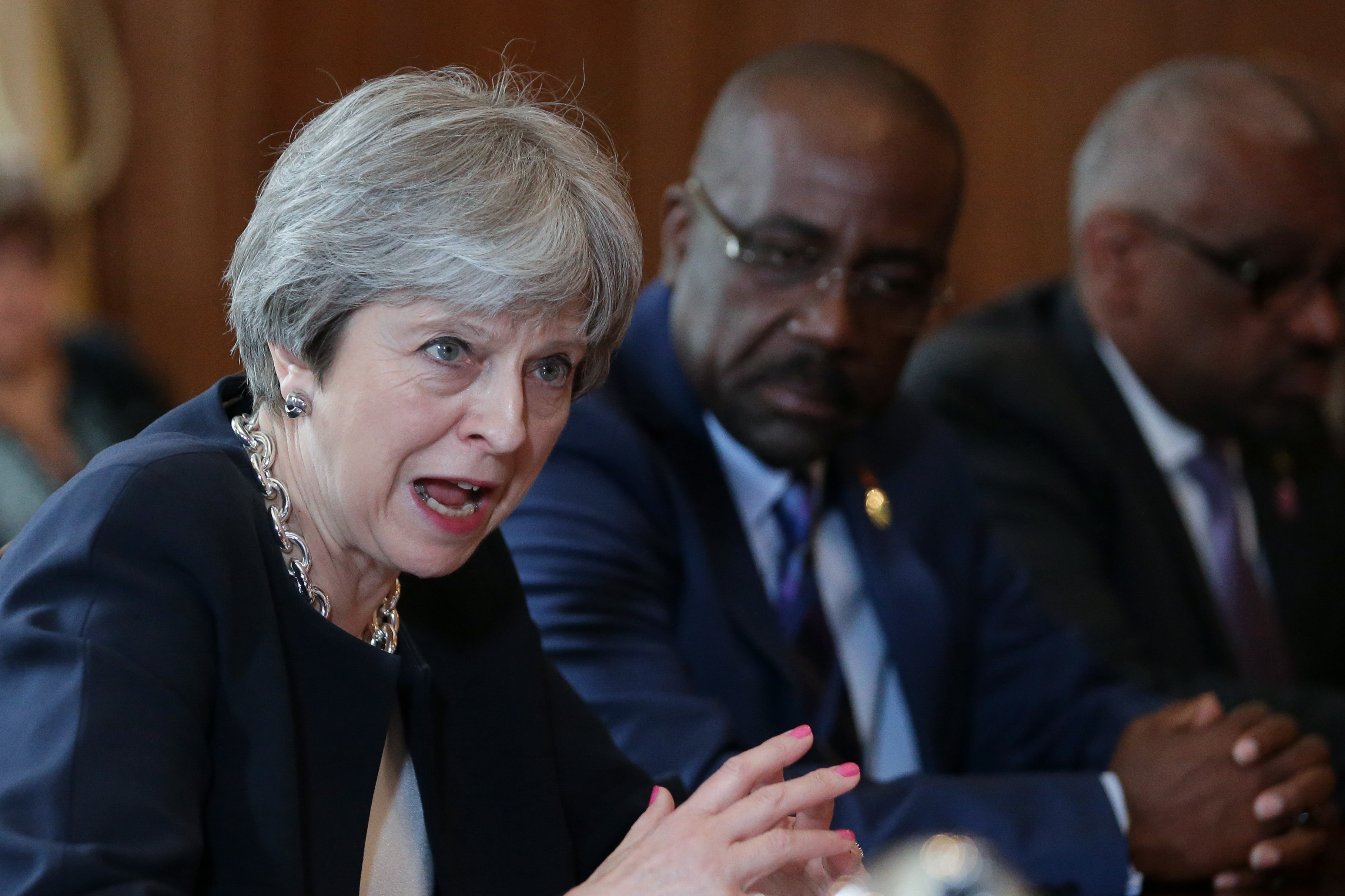 """LONDON, ENGLAND - APRIL 17: Britain's Prime Minister Theresa May hosts a meeting with leaders and representatives of Caribbean countries at 10 Downing Street on April 17, 2017 in London, England. Theresa May is meeting Caribbean leaders as the Government faces severe criticism over the treatment of the """"Windrush"""" generation of British residents. (Photo by Daniel Leal-Olivas - WPA Pool/Getty Images)"""
