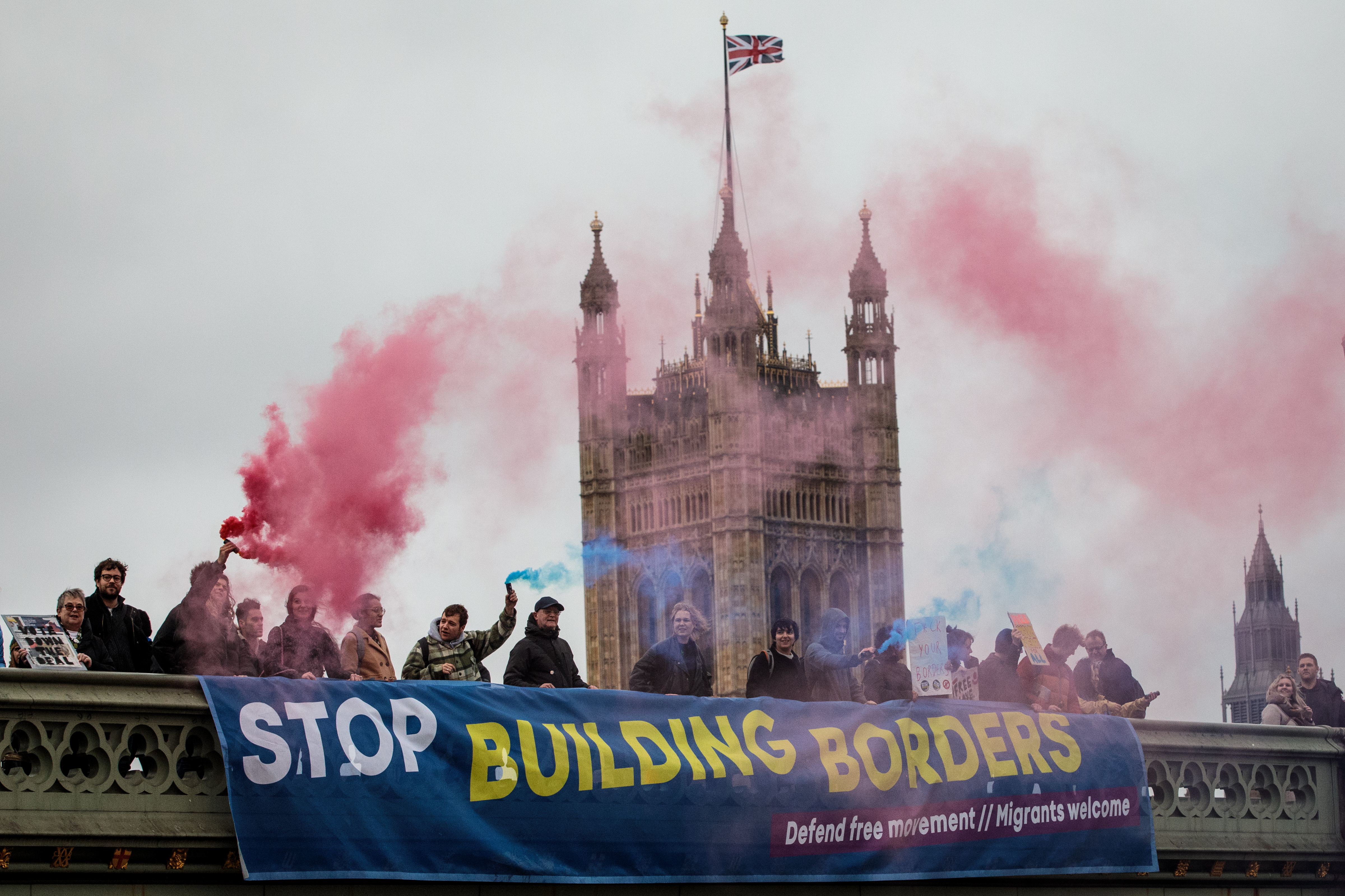 LONDON, ENGLAND - NOVEMBER 28: Activists in support of freedom of movement demonstrate against Theresa May's Brexit plan by hanging a banner from Westminster Bridge on November 28, 2018 in London, England. British Prime Minister Theresa May May will visit Scotland today as she continues her tour of the UK ahead of a crucial vote on her Brexit plan in Parliament in December. (Photo by Jack Taylor/Getty Images)