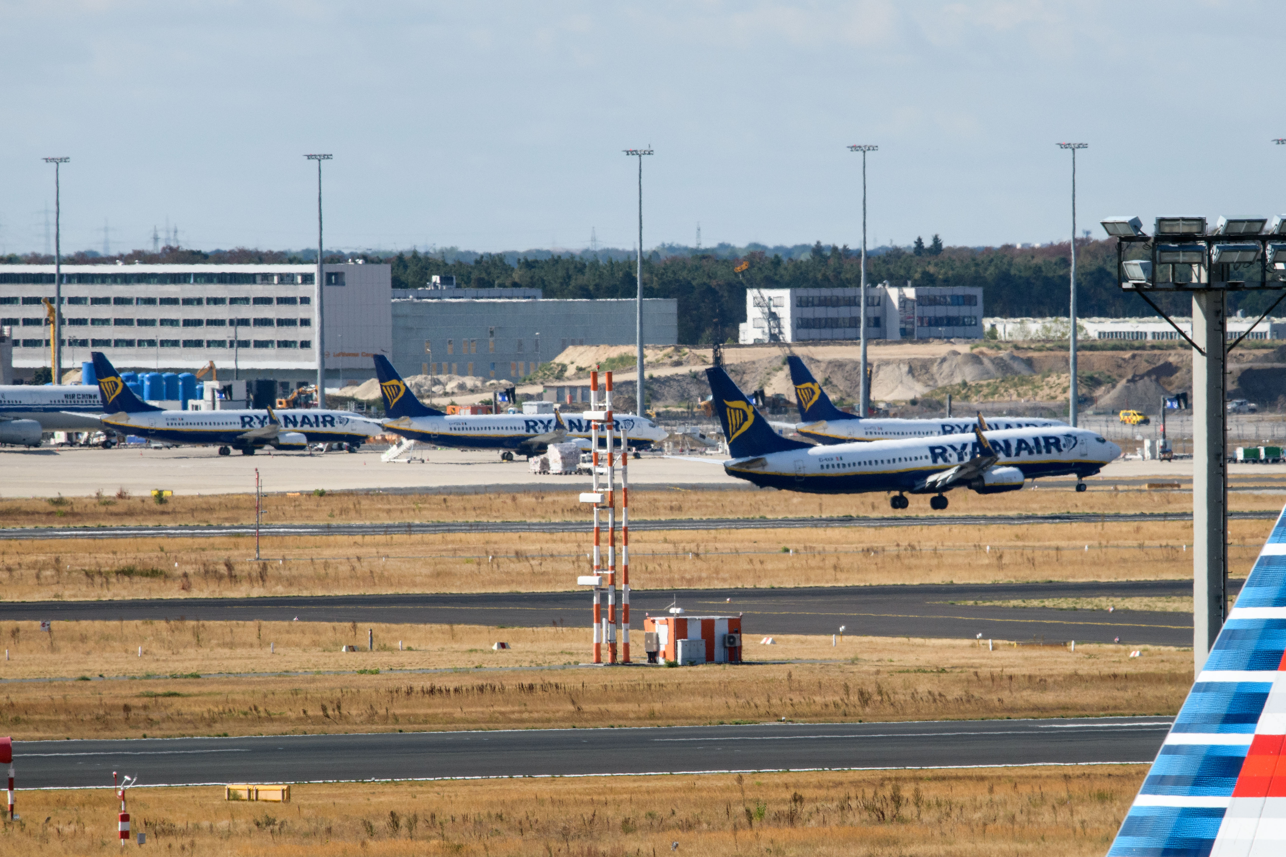 FRANKFURT AM MAIN, GERMANY - AUGUST 10: An airplane of discount airliner RyanAir lands during a 24-hour strike by the pilots while other stand at the Frankfurt Airport on August 10, 2018 in Frankfurt, Germany. RyanAir pilots in Germany, Ireland, Sweden, Belgium and Holland are taking part in the strike over demands for better pay and working conditions. (Photo by Thomas Lohnes/Getty Images)
