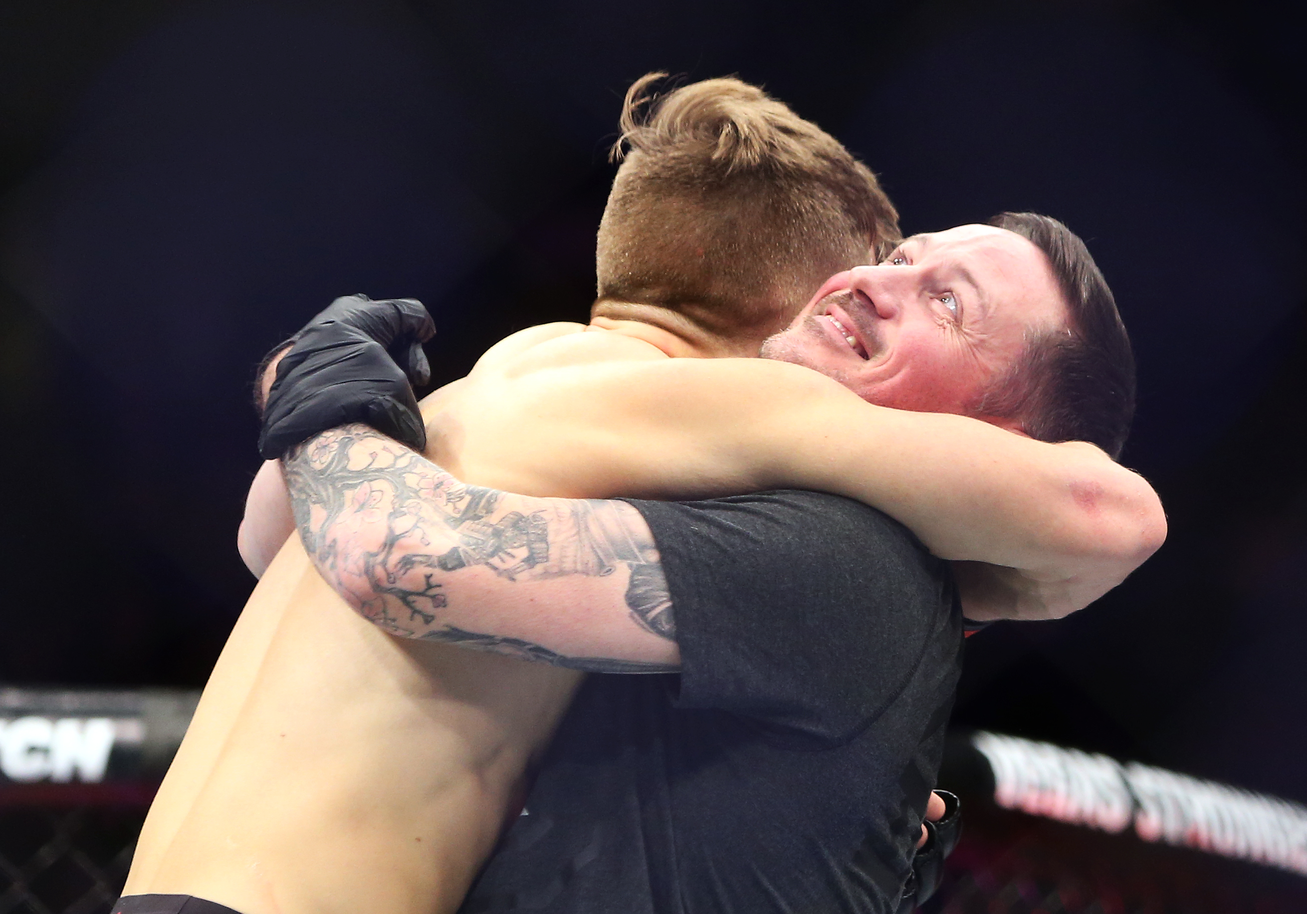 TORONTO, ON - DECEMBER 8:  Brad Katona of Canada celebrates with coach John Kavanagh after victory against Matthew Lopez of the United States in a bantamweight bout during the UFC 231 event at Scotiabank Arena on December 8, 2018 in Toronto, Canada.  (Photo by Vaughn Ridley/Getty Images)