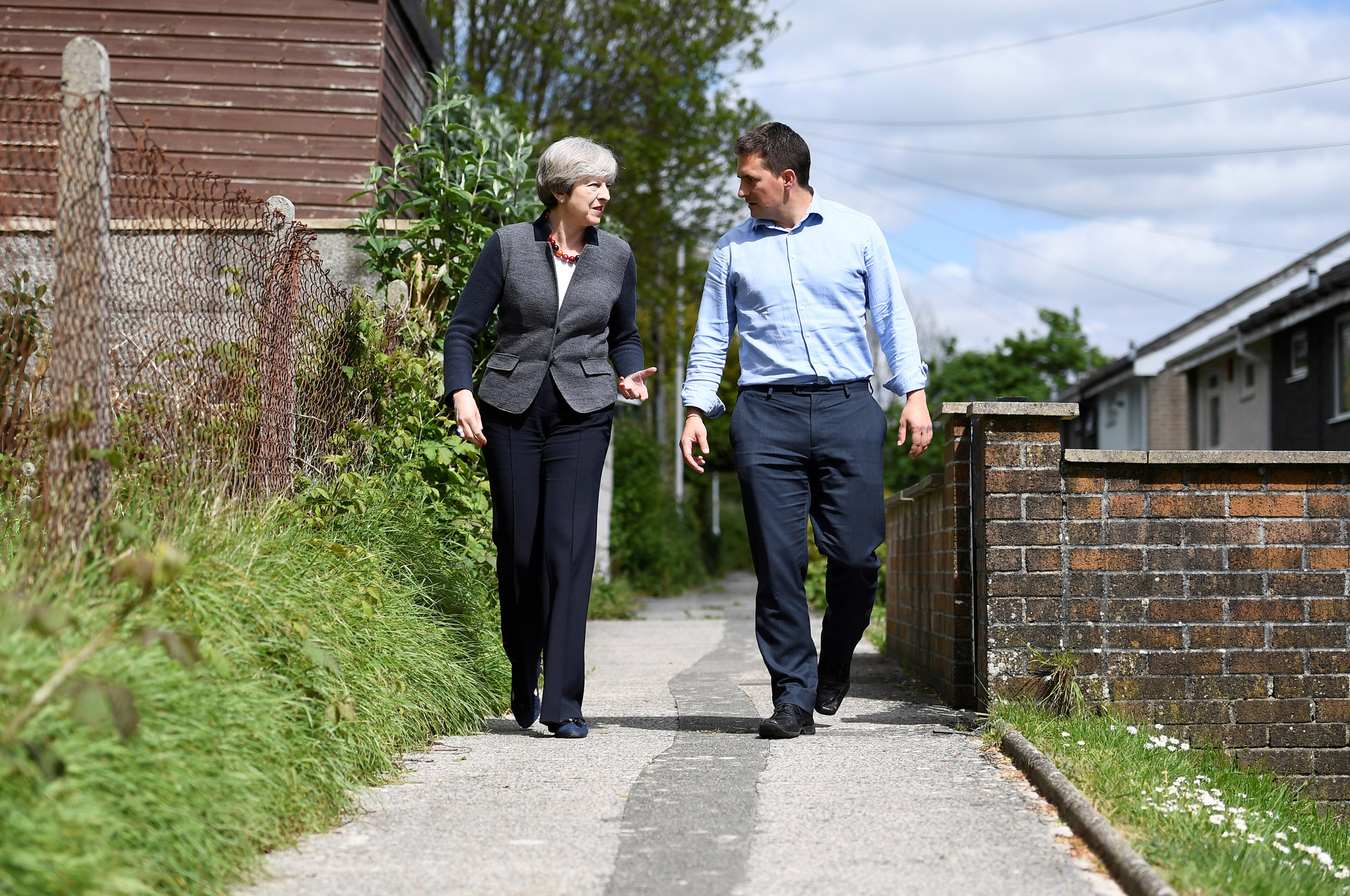 PLYMOUTH, UNITED KINGDOM - MAY 2: Britain's Prime Minister Theresa May walks with local Conservative Party candidate Johnny Mercer during a campaign visit on May 2, 2017 in Plymouth, England. The Prime Minister is campaigning in South-West England, a former Liberal Democrat stronghold, as she urges West Country voters to stick with her party ahead of the polls on June 8. (Photo by Dylan Martinez/WPA Pool/Getty Images)
