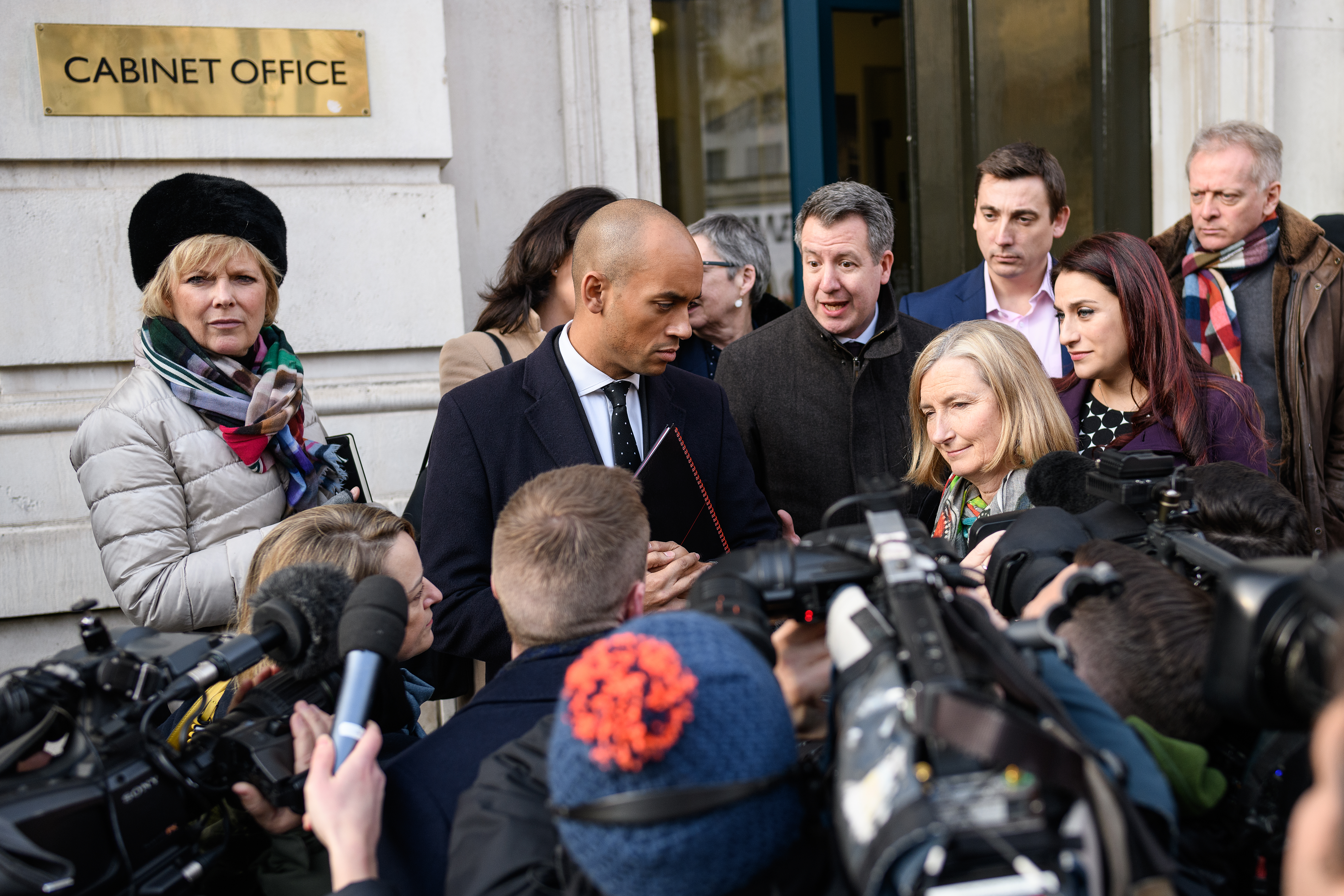 """LONDON, ENGLAND - JANUARY 21: Conservative MP Anna Soubry (L), Labour MP Chuka Umunna (2L), Labour MP Chris Leslie (3L), Conservative MP Sarah Wollaston (3R), Labour MP Gavin Shuker (3R), Labour MP Luciana Berger (2R) and Conservative MP Phillip Lee (R) speak with the media outside the Cabinet Office following a Brexit meeting with Theresa May's Chief of Staff Gavin Barwell and David Liddington MP on January 21, 2019 in London, England. British Prime Minister Theresa May is set to attempt to convince Conservative Brexiteers and DUP MPs to back her current withdrawal deal by resolving Irish backstop concerns. Her attempts to reach a cross-party agreement last week were thwarted after the Labour Party leader Jeremy Corbyn insisted on the removal of leaving the European Union with """"no deal"""" as an option in the negotations on how to proceed with Brexit, before he would talk to the Government. (Photo by Leon Neal/Getty Images)"""