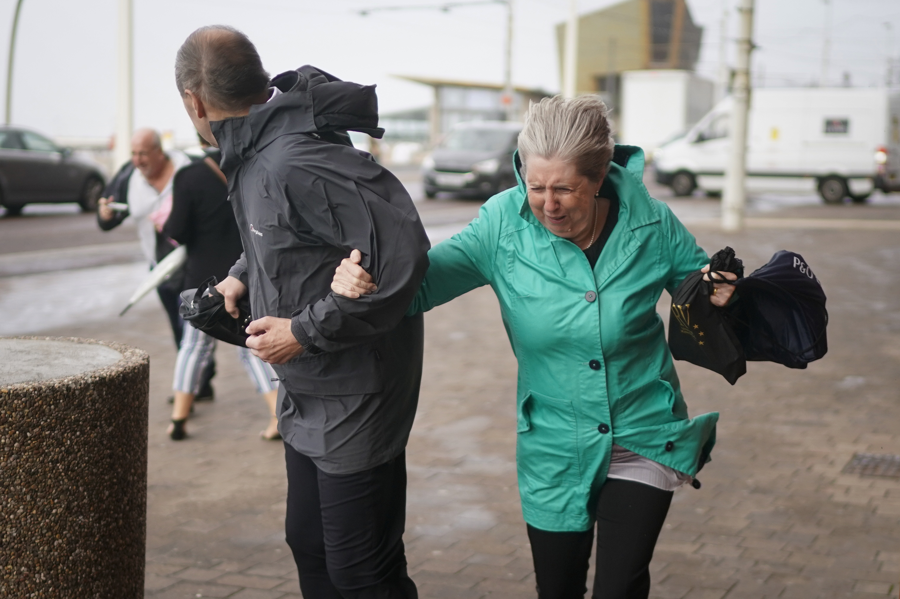 BLACKPOOL, ENGLAND - SEPTEMBER 19: Members of the public struggle in the wind as Storm Ali hits land on September 19, 2018 in Blackpool, England. Severe gales which are set to get up to as much as 80mph are causing road, rail and ferry travel disruption as Storm Ali hits parts of the United Kigndom. (Photo by Christopher Furlong/Getty Images)