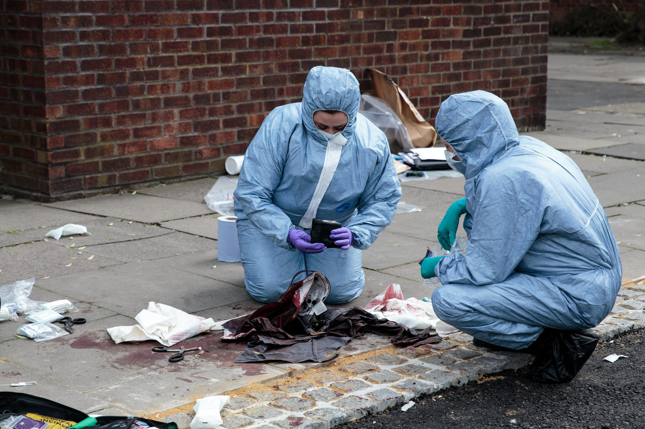 Forensic officers from the Metropolitan Police attend the scene of a stabbing in London.
