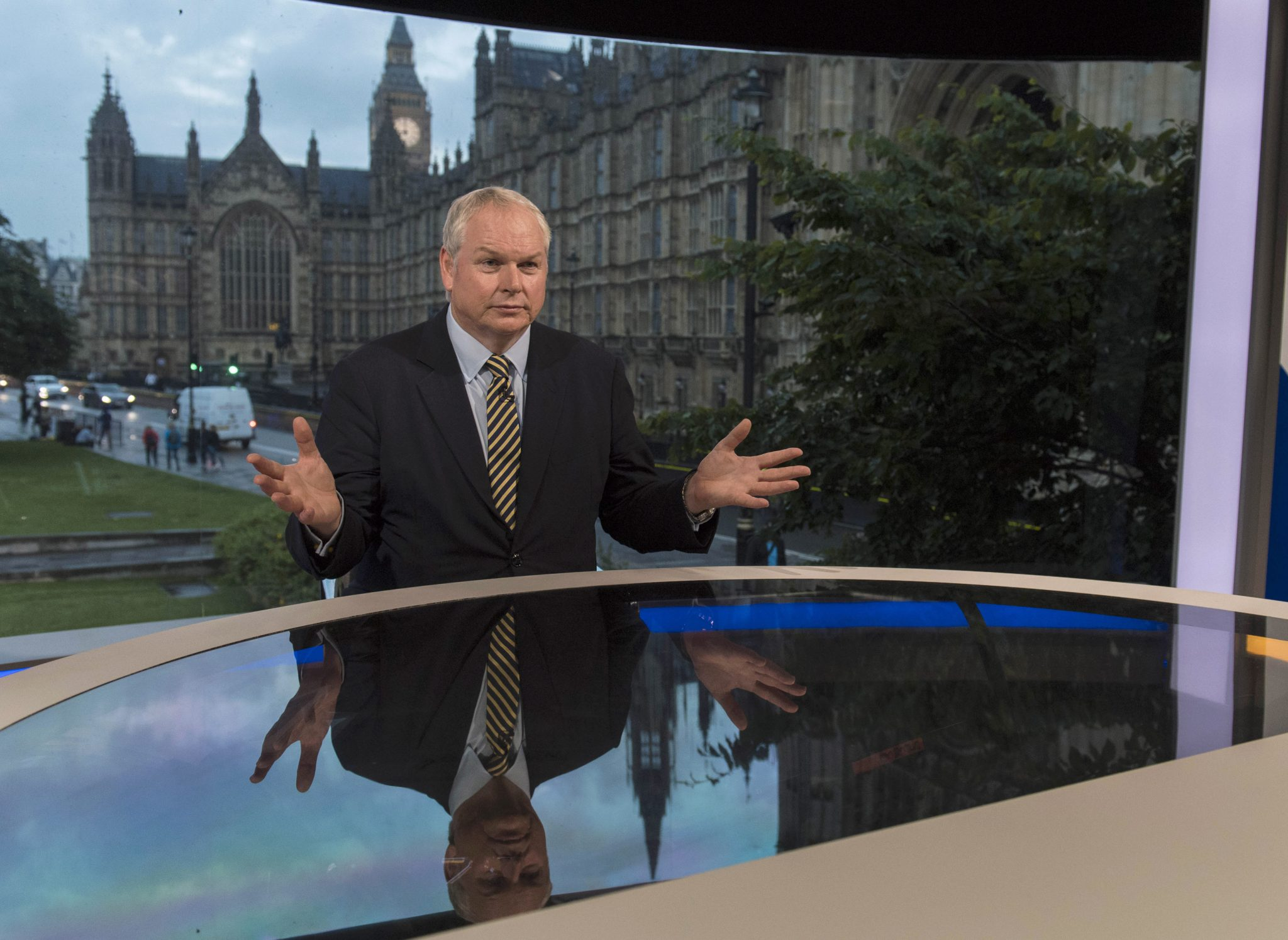 In this handout image provided by Sky News, Adam Boulton prepares to deliver the referendum results on June 23, 2016 in London, England. (Photo by Chris Lobina/Sky News via Getty Images)