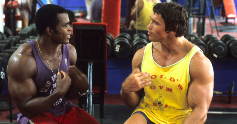 Arnold Schwarzenegger in the gym with Serge Nubret