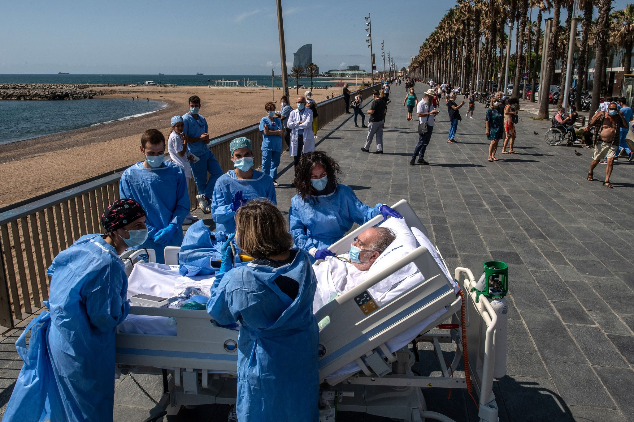 A patient recovering from coronavirus at Barcelona hospital is taken by doctors to the beach
