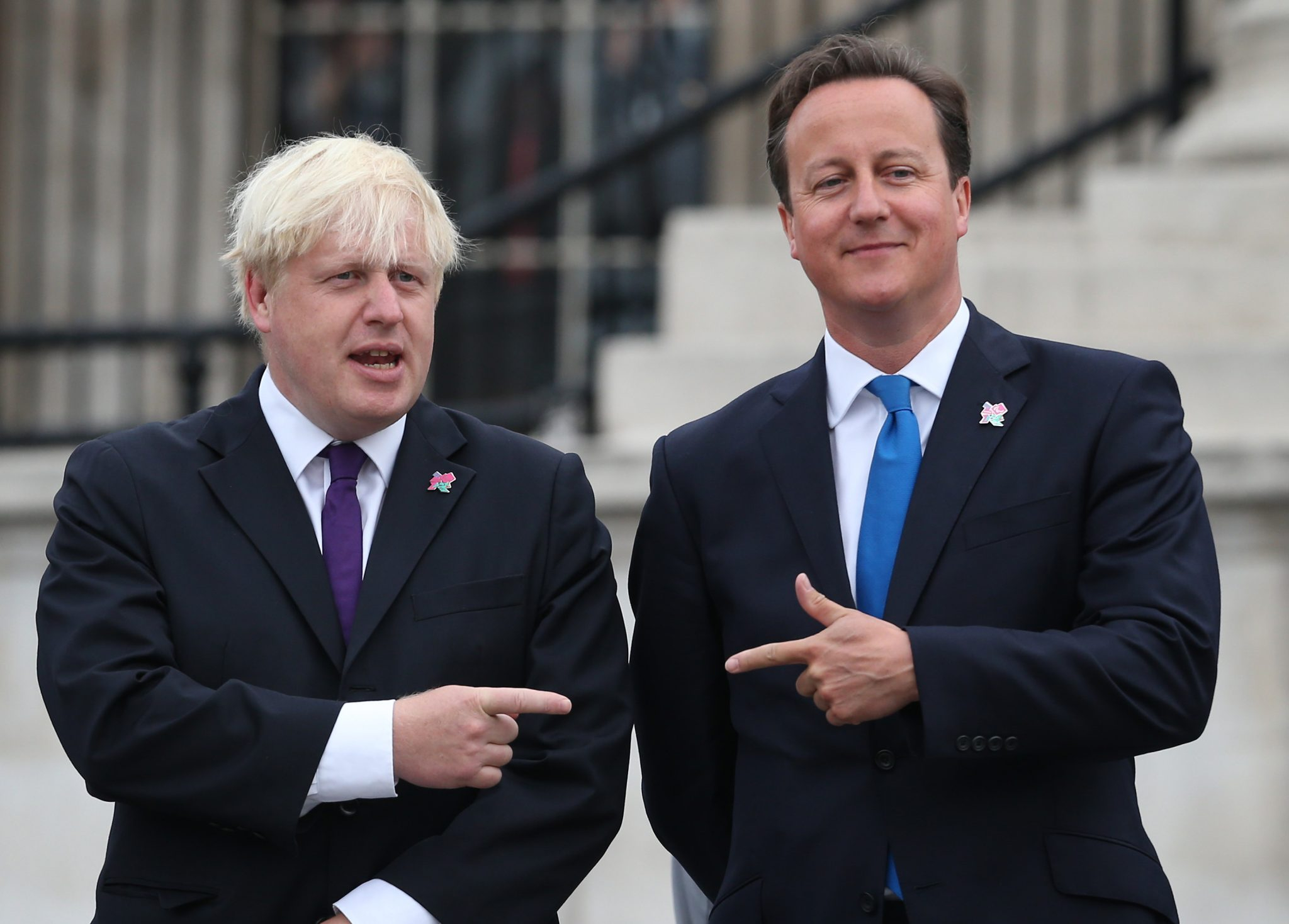 David Cameron and Boris Johnson pointing at each other