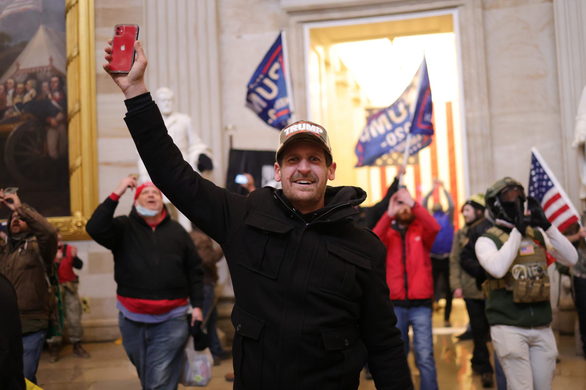A man holds his smart phone aloft during the riot at the Capitol in Washington DC by a far-right mob supporting Donald Trump