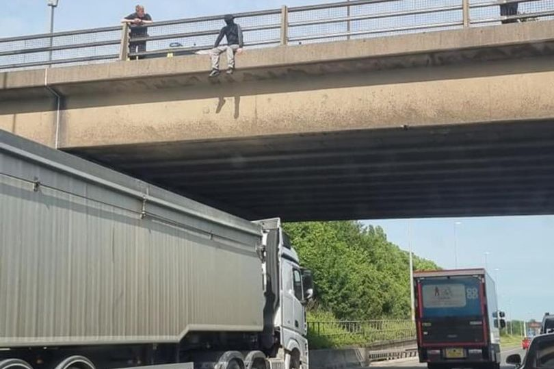 Lorry drover saves man from jumping off M62 bridge