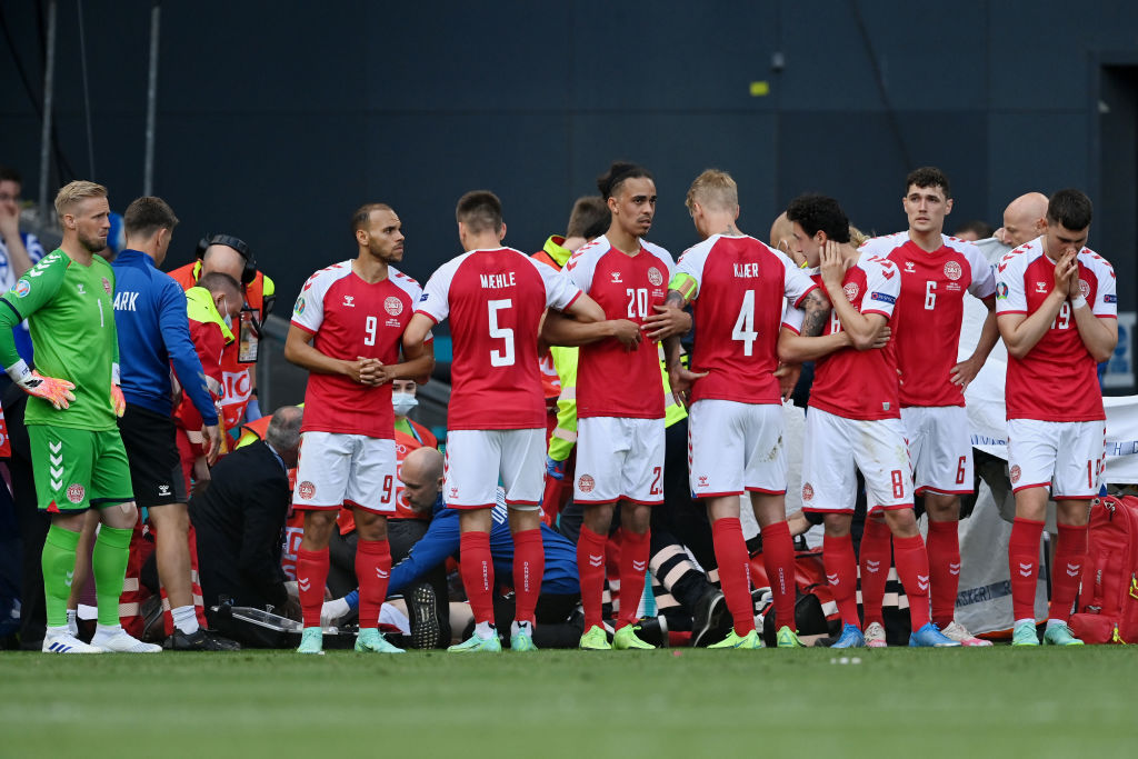 Denmark players protect Eriksen as he receives CPR