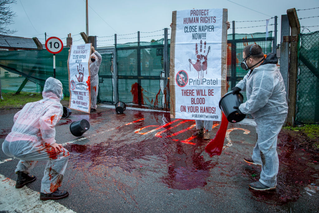 Protestors throw fake blood over poor conditions at Napier immigration barracks