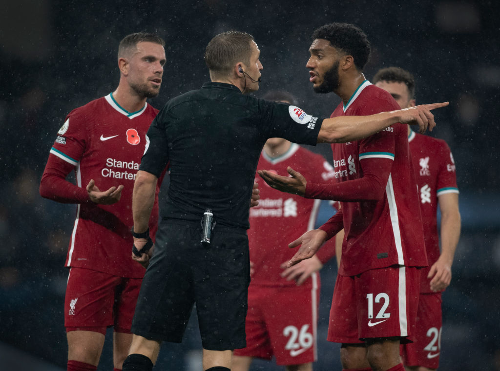 Liverpool players protest handball decision against Man City