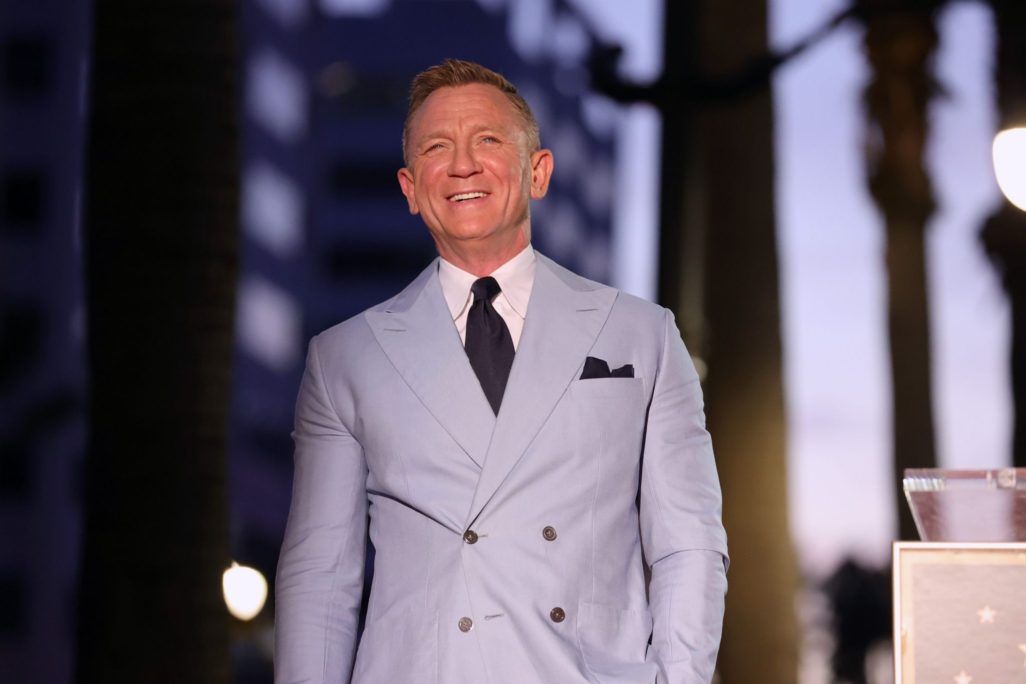 Daniel Craig says he often goes to gay bars to get away from aggressive men